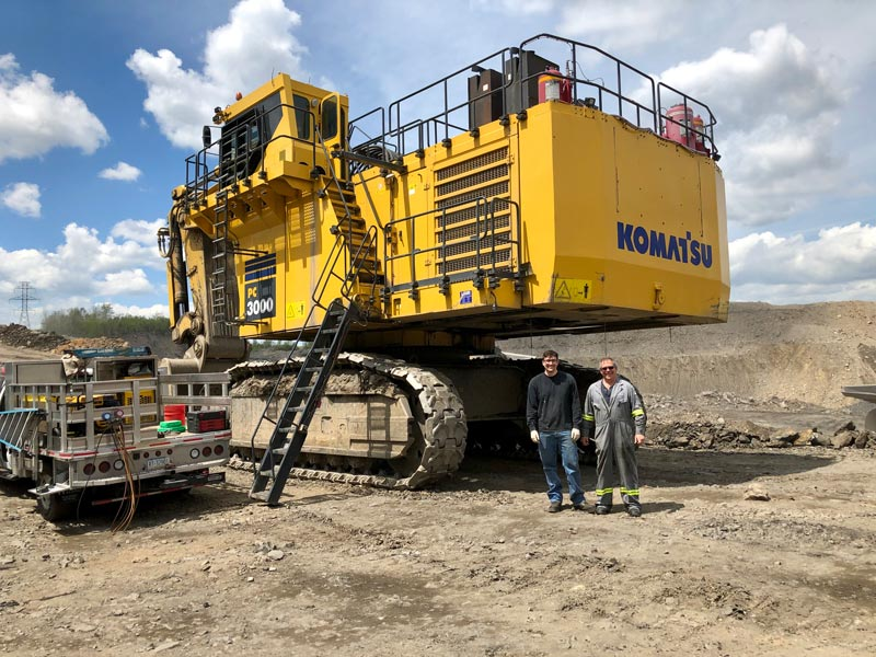 Cicioni performing maintenance on a Komatsu-PC-3000.